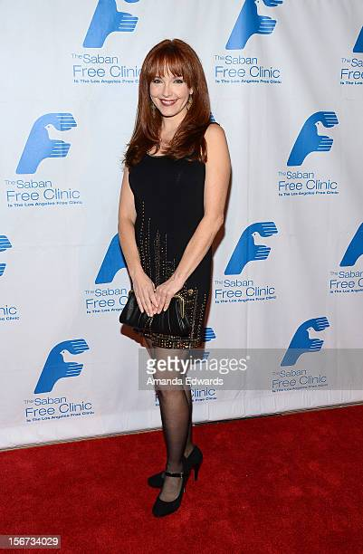 Actress Amy Yasbeck arrives at the Saban Free Clinic's 36th Annual Dinner Gala at The Beverly Hilton Hotel on November 19 2012 in Beverly Hills...