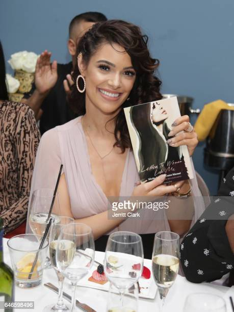 Actress Anabelle Acosta poses with a copy of Mirtha Michelles Book 'Letters To Women Like Me' during her 30th Birthday Party at The Esterel...