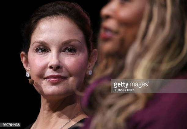 Actress and activist Ashley Judd looks on as Adama Iwu speaks during the 29th annual Conference of the Professional Businesswomen of California on...
