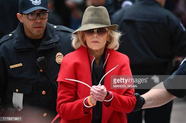 TOPSHOT Actress and activist Jane Fonda is arrested by Capitol Police during a climate protest inside the Hart Senate office building on November 1...