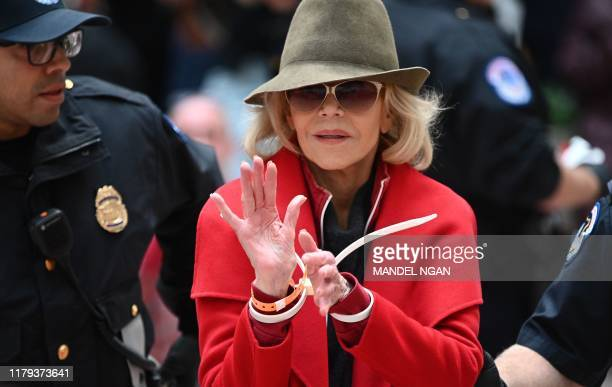 Actress and activist Jane Fonda is arrested by Capitol Police during a climate protest inside the Hart Senate office building on November 1 2019 in...