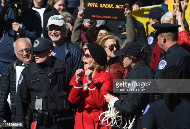 Actress and activist Jane Fonda is arrested outside the US Capitol during a climate change protest on October 18 2019 in Washington DC