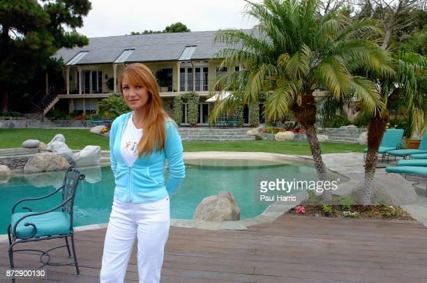 Actress and artist Jane Seymour stands enjoys tea in her garden of her home overlooking the Pacific ocean on June 12 2002 in Malibu California