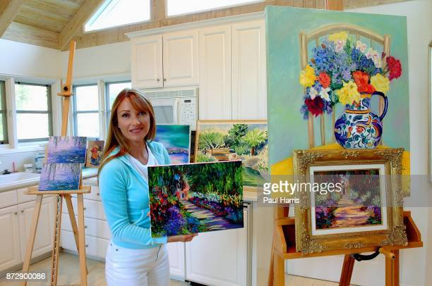 Actress and artist Jane Seymour stands in her art studio and dressing room in her home overlooking the Pacific ocean with various items of her...