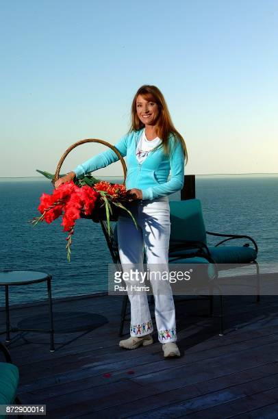 Actress and artist Jane Seymour stands on the deck of her home overlooking the Pacific ocean with items picked from her garden on June 12 2002 in...