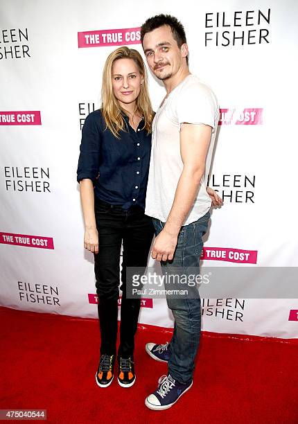 Actress and athlete Aimee Mullins and actor Rupert Friend attend 'The True Cost' New York Premiere at IFC Center on May 28 2015 in New York City