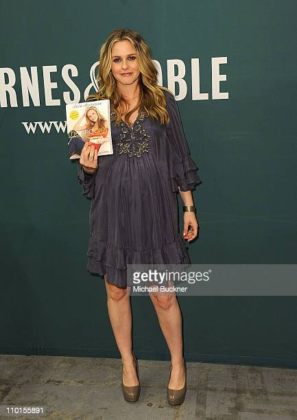 Actress and author Alicia Silverstone poses with her new book 'The Kind Diet' at Barnes Noble on March 15 2011 in Los Angeles California