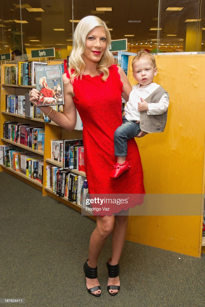 Actress and author Tori Spelling (L) and daughter Hattie McDermott attend as Tori Spelling signs copies of her new book 'Spelling It Like It Is' at Barnes & Noble bookstore at The Grove on November 9, 2013 in Los Angeles, California.