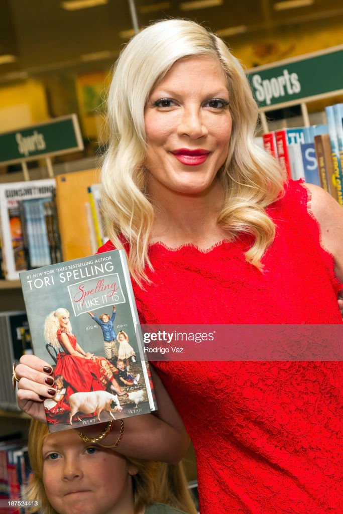 Actress and author Tori Spelling signs copies of her new book 'Spelling It Like It Is' at Barnes & Noble bookstore at The Grove on November 9, 2013 in Los Angeles, California.