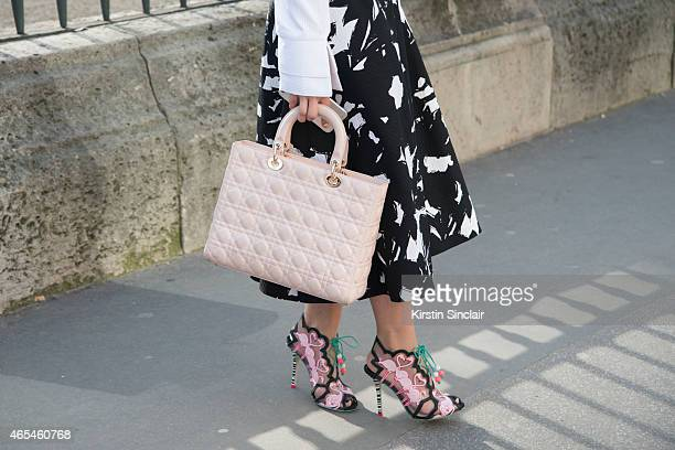 Actress and blogger Marta Pozzan wears Audra skirt Dior bag Banana Republic skirt and Sophia Webster shoes on day 4 of Paris Collections Women on...
