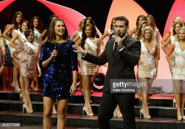 Actress and cohost Michelle Nunes and radio personality and cohost Rich Davis speak during the 21st annual Hooters International Swimsuit Pageant at...