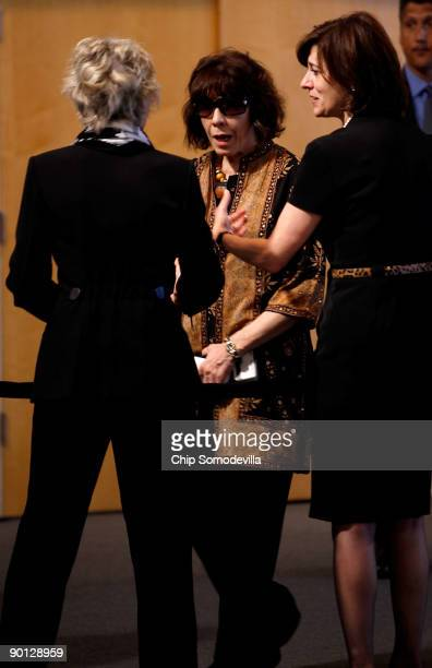 Actress and comedian Lily Tomlin greets Joan Kennedy and Victoria Kennedy wife of Sen Edward Kennedy at the John F Kennedy Presidential Library and...