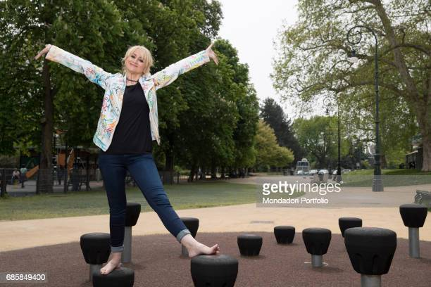 Actress and comedian Luciana Littizzetto with open arms inside the public park Parco del Valentino Turin Italy 21st April 2016