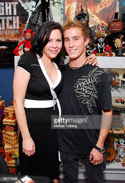 Actress and current Playboy model Christa Campbell poses with actor Ryan Fleming at an autograph party for the new graphic novel '2001 Maniacs' held...