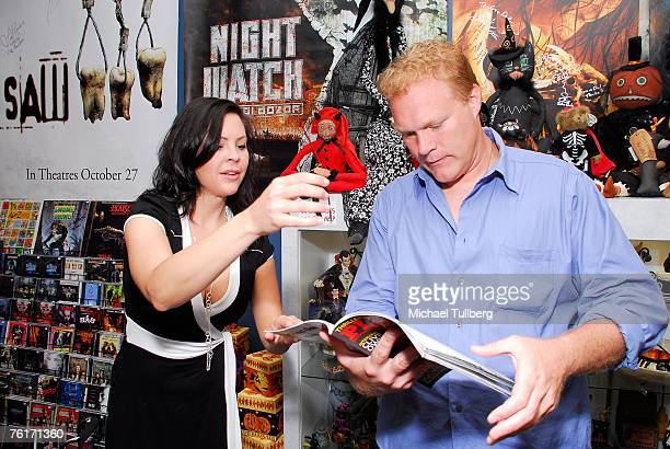 Actress and current Playboy model Christa Campbell shows director Tim Sullivan her new Playboy magazine photo spread for the first time at an...