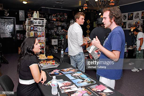Actress and current Playboy model Christa Campbell talks with a fan at an autograph party for the new graphic novel '2001 Maniacs' held at the Dark...