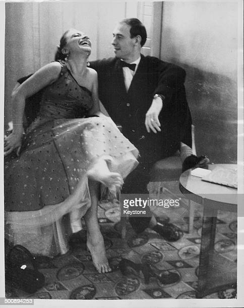 Actress and dancer April Olrich and comedian Bill Maynard laughing together at the Tin Pan Alley Ball Dorchester Hotel London October 27th 1956