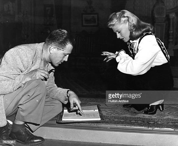 Actress and dancer Ginger Rogers discusses her new role in 'Tender Comrade' with her director Edward Dmytryk