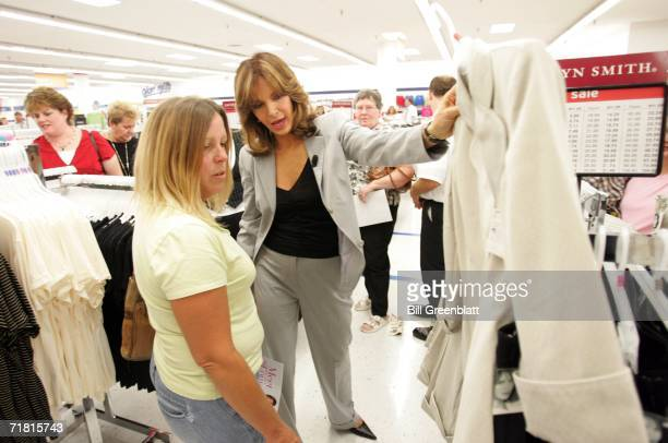 Actress and designer Jaclyn Smith shows off one of her new fall jackets to Caryl Sellers of East Alton Il during an appearance at a KMart Store in St...