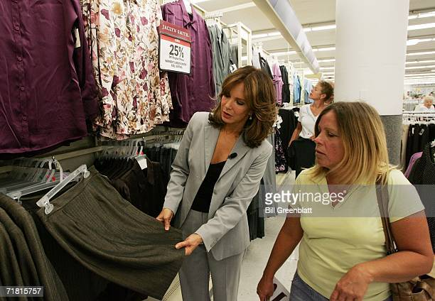 Actress and designer Jaclyn Smith shows off one of her new fall skirts to Caryl Sellers of East Alton Il during an appearance at a KMart Store in St...