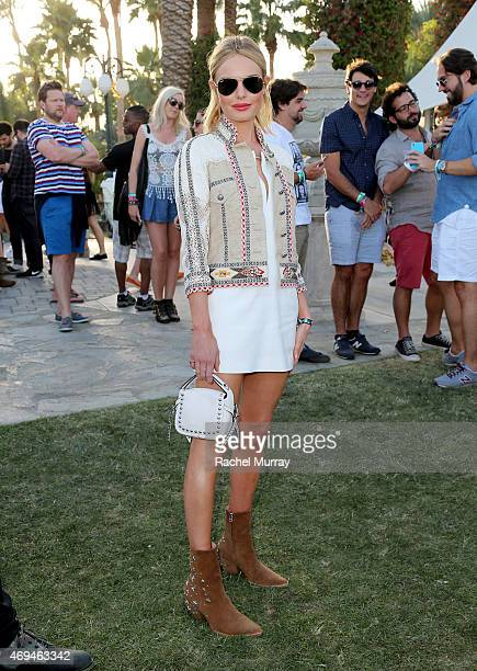 Actress and designer Kate Bosworth wearing boots she designed and a Coach handbag attends the 2015 Coachella Valley Music and Arts Festival Weekend 1...