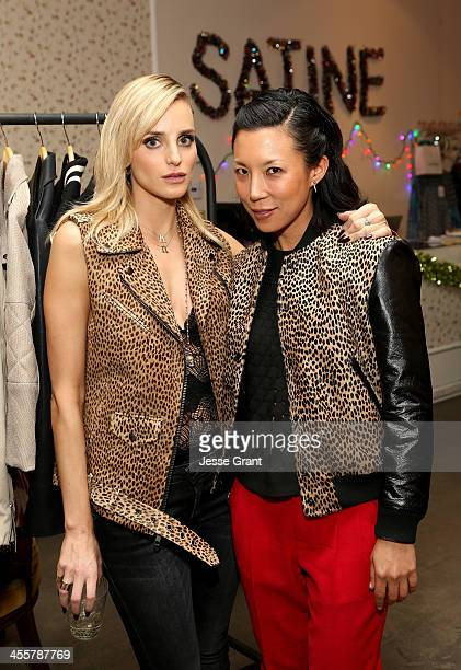 Actress and designer Katie Nehra and Satine owner Jeannie Lee attend the SIMONE SATINE Holiday Party at Satine on December 12 2013 in Los Angeles...