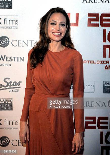 """Actress and director Angelina Jolie poses before the premiere of her film """"In the Land of Blood and Honey"""" in the Croatian capital Zagreb, on..."""