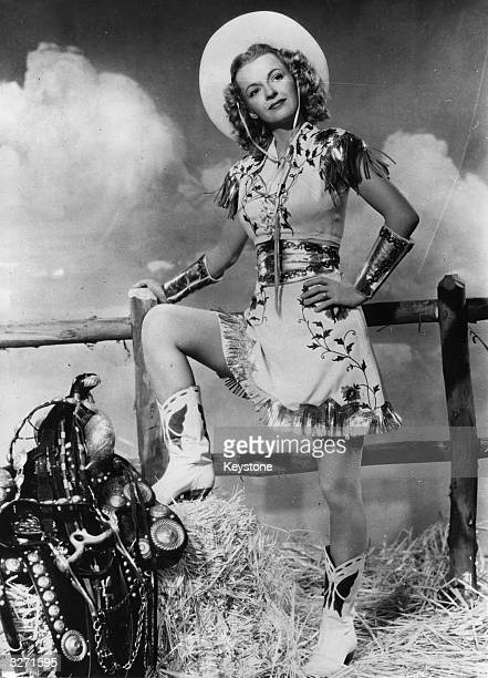 US actress and evangelist Dale Evans dressed in a Wild West outfit