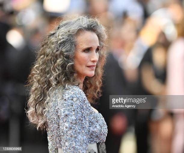 Actress and fashion model Andie MacDowell arrives for the screening of the film âAnnette' in competition and the Opening Ceremony of the 74th annual...