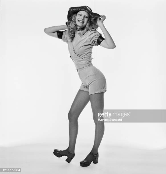 Actress and fashion model Ika Hindley wears hotpants and short sleeved wrap top with sunhat 1st February 1971