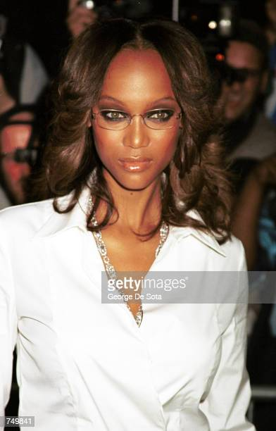 Actress and fashion model Tyra Banks poses for photographers July 31, 2000 at the premiere of Coyote Ugly at the Ziegfeld Theatre in New York City.