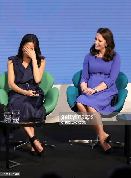 US actress and fiancee of Britain's Prince Harry Meghan Markle and Britain's Catherine Duchess of Cambridge attend the first annual Royal Foundation...