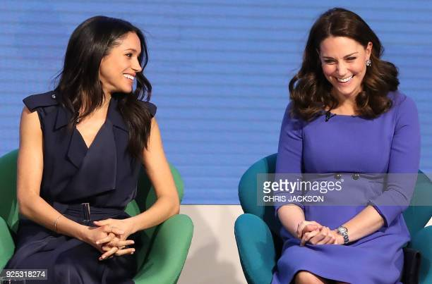 TOPSHOT US actress and fiancee of Britain's Prince Harry Meghan Markle and Britain's Catherine Duchess of Cambridge attend the first annual Royal...