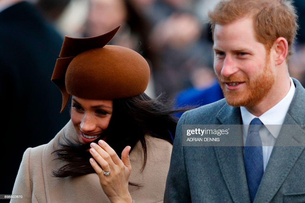 US actress and fiancee of Britain's Prince Harry Meghan Markle and Britain's Prince Harry arrive to attend the Royal Family's traditional Christmas Day church service at St Mary Magdalene Church in Sandringham, Norfolk, eastern England, on December 25, 2017. / AFP PHOTO / Adrian DENNIS