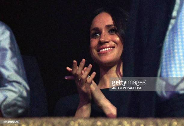 US actress and fiancee of Britain's Prince Harry Meghan Markle applauds during The Queen's Birthday Party concert on the occassion of Her Majesty's...