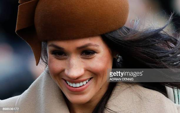 US actress and fiancee of Britain's Prince Harry Meghan Markle arrives to attend the Royal Family's traditional Christmas Day church service at St...
