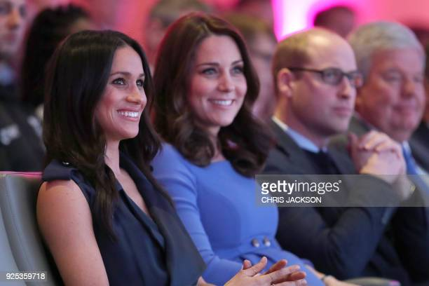US actress and fiancee of Britain's Prince Harry Meghan Markle Britain's Catherine Duchess of Cambridge and Britain's William Duke of Cambridge...