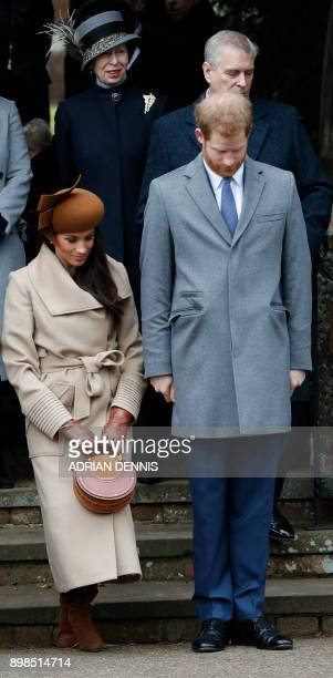 US actress and fiancee of Britain's Prince Harry Meghan Markle curtseys as Britain's Prince Harry bows as they see off Britain's Queen Elizabeth II...