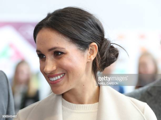 US actress and fiancee of Britain's Prince Harry Meghan Markle gestures during a visit at the Eikon Centre in Lisburn on March 23 to attend an event...