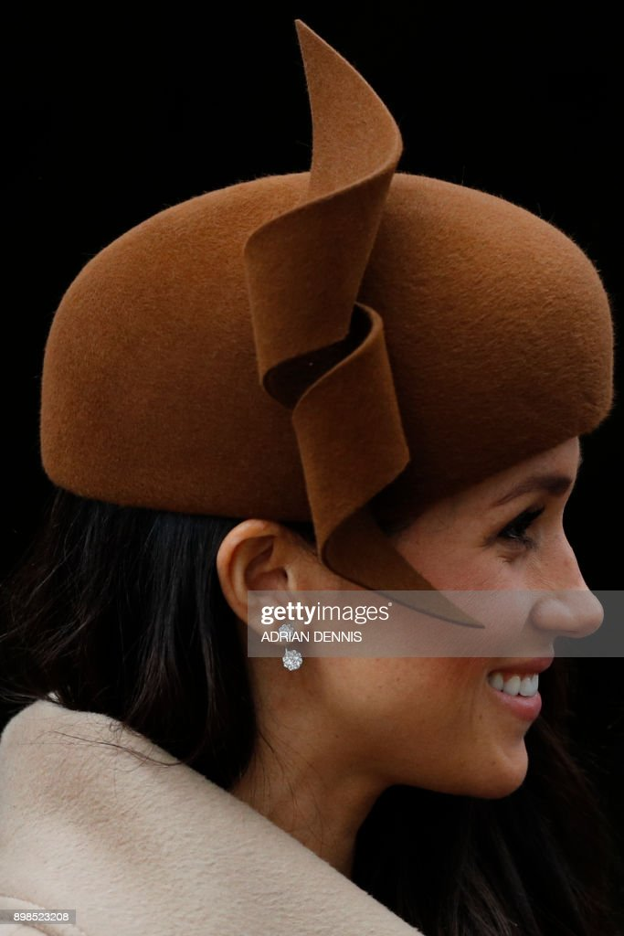 US actress and fiancee of Britain's Prince Harry Meghan Markle leaves after attending Royal Family's traditional Christmas Day church service at St Mary Magdalene Church in Sandringham, Norfolk, eastern England, on December 25, 2017. / AFP PHOTO / Adrian DENNIS