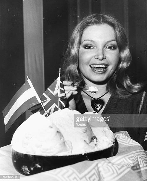 Actress and former Miss World Eva RueberStaier trying an Austrian meal at the Salzburg Food Festival at the Britannia Hotel in London April 26th 1976