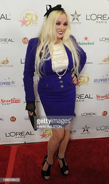 Actress and former pinup girl Mamie Van Doren arrives on the red carpet for the 50th anniversary birthday bash for the Hollywood Walk of Fame at the...