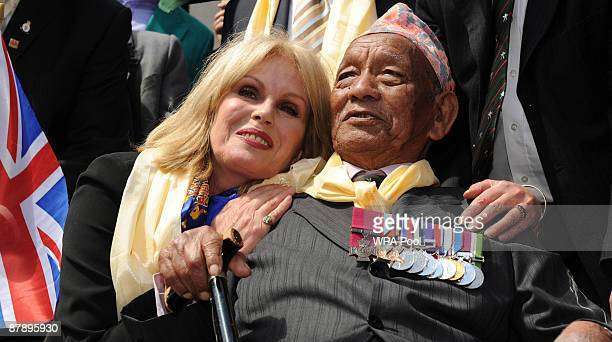 Actress and Gurkha campaigner Joanna Lumley celebrates with a retired Gurkha soldier adjacent to the Houses of Parliament on May 21 2009 in London...