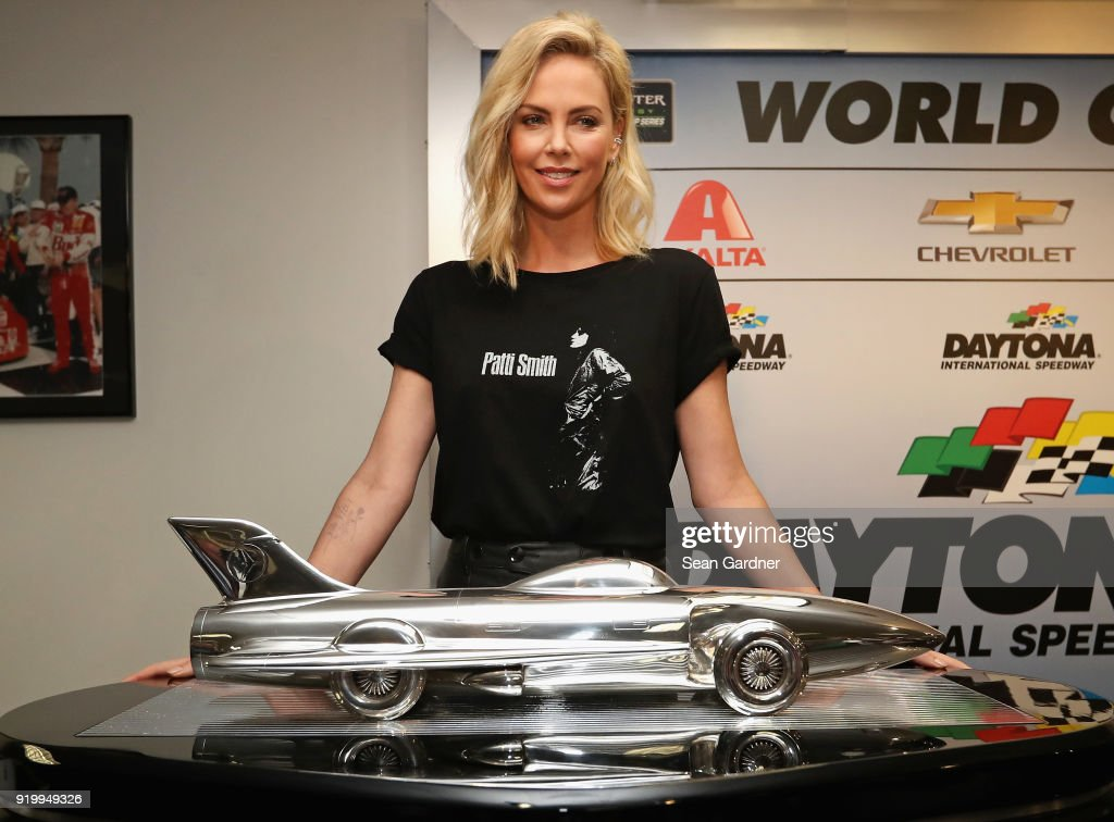 Actress and honorary starter, Charlize Theron, speaks with the media during a press conference before the Monster Energy NASCAR Cup Series 60th Annual Daytona 500 at Daytona International Speedway on February 18, 2018 in Daytona Beach, Florida.