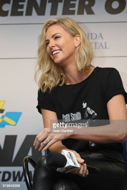 Actress and honorary starter Charlize Theron speaks with the media during a press conference before the Monster Energy NASCAR Cup Series 60th Annual...