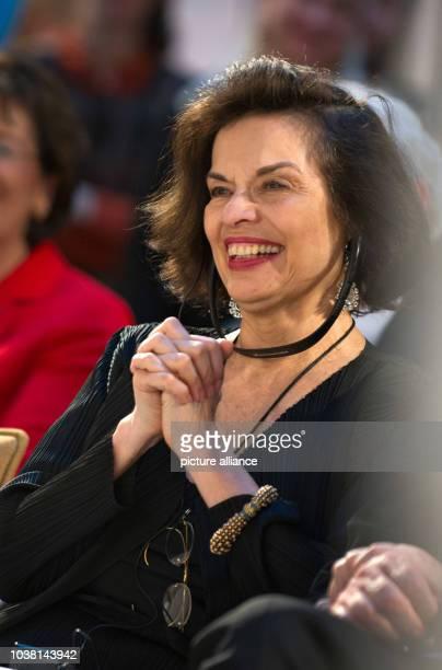 Actress and human rights activist Bianca Jagger listens to a speech during the opening of the exhibition 'Ihrer Zeit voraus Visionaere Frauen im...
