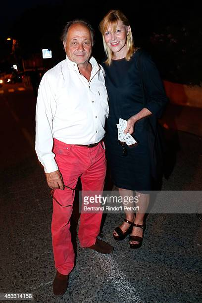 Actress and humorist Chantal Ladesou and her husband Michel Ansault attend the 30th Ramatuelle Festival Day 7 on August 7 2014 in Ramatuelle France