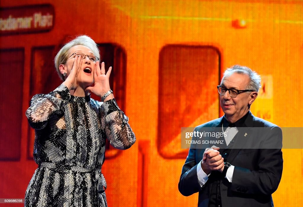 TOPSHOT - US actress and jury president Meryl Streep (L) and festival director Dieter Kosslick take the stage prior to the film 'Hail, Caesar!' screening as opening film of the 66th Berlinale Film Festival in Berlin on February 11, 2016. Eighteen pictures will vie for the Golden Bear top prize at the event which runs from February 11 to 21, 2016. /