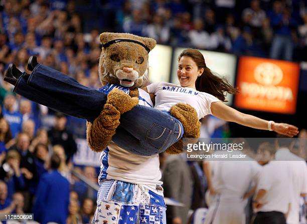 Actress and Kentucky alum Ashley Judd gets spun around by the Wildcat after she formed the 'Y' during a cheer in the second half of the...