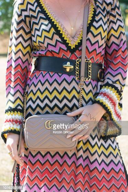Actress and Made in Chlesea star Rosie Fortescue wears a Missoni dress Chanel belt Gucci bag and Rosie Fortescue jewellery during Wilderness Festival...